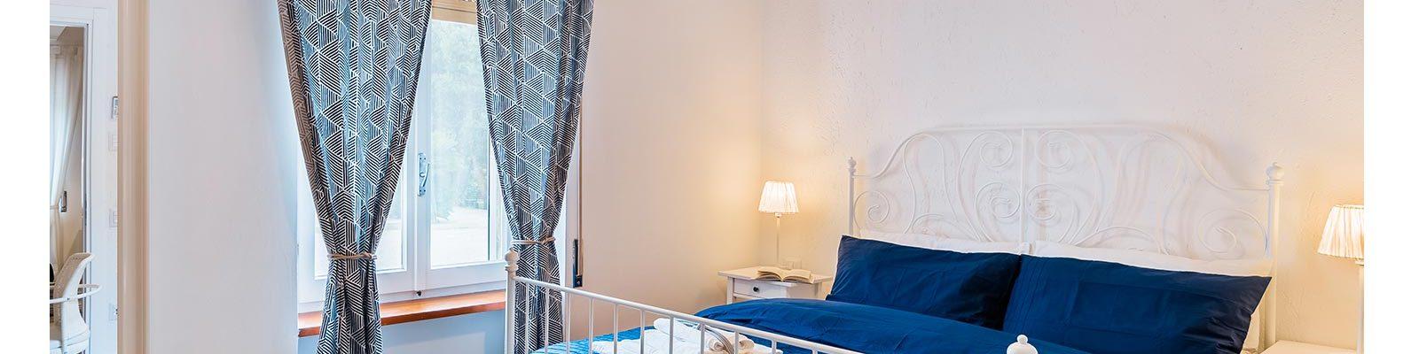 Camera da letto in appartamento vacanze a Sabaudia